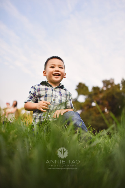 South-Bay-lifestyle-photography-preschooler-boy-kneeling-happily-in-grass