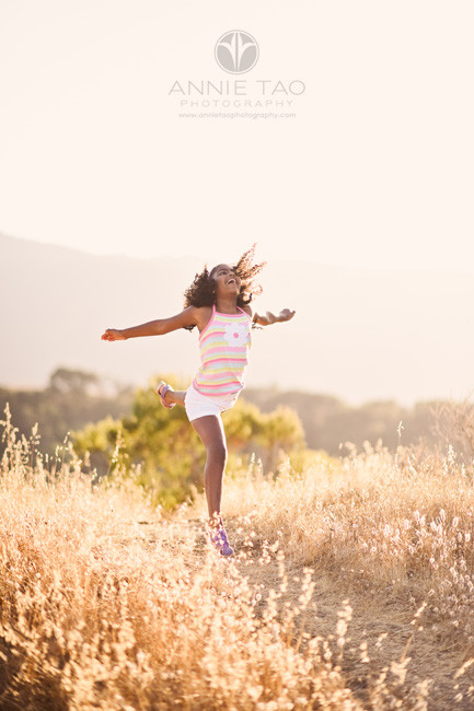 Bay-Area-lifestyle-children-photography-girl-jumping-in-air-at-sunset