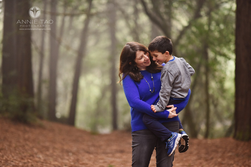 East-Bay-lifestyle-family-photography-woman-carrying-young-son-in-forest
