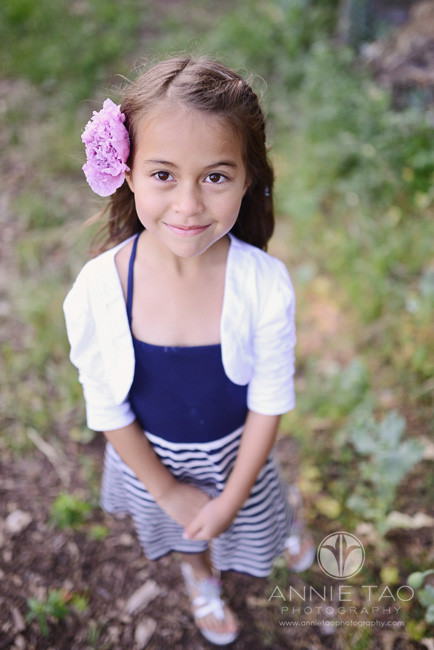 East-Bay-lifestyle-children-photography-young-girl-in-blue-and-white-with-flower-in-her-hair-fulllength