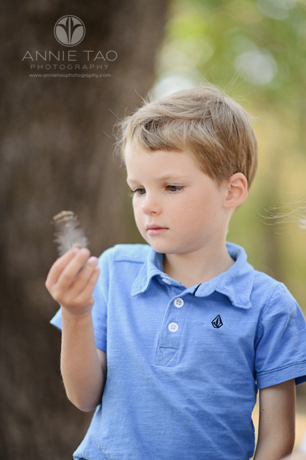 East-Bay-lifestyle-children-photography-young-boy-looking-at-feather