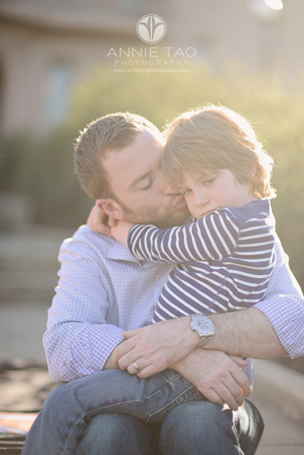 Bay-Area-styled-family-photography-young-boy-snuggling-with-dad-in-blanket-of-sunlight
