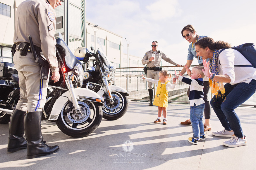 San-Francisco-lifestyle-family-photography-parents-with-two-toddlers-stick-them-up-with-police-officers