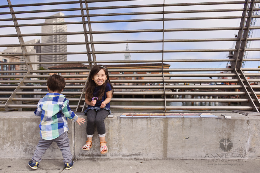 San-Francisco-lifestyle-children-photography-toddler-brother-walking-through-while-sister-giggles