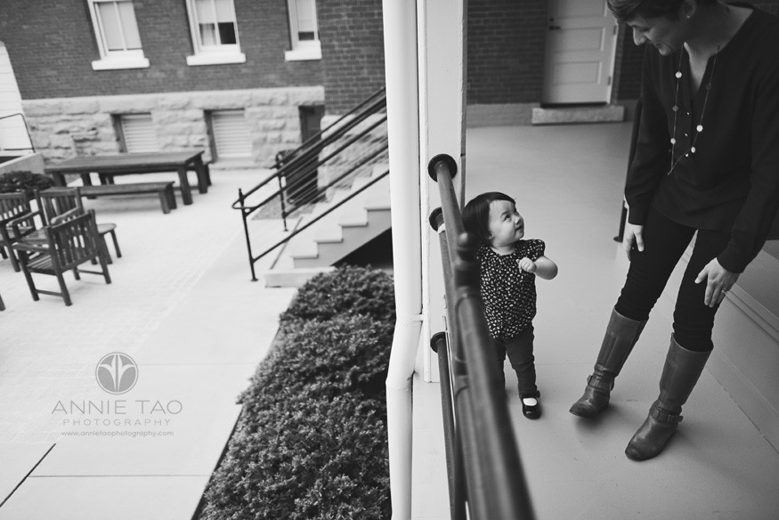 San-Francisco-lifestyle-family-photography-toddler-looking-up-at-her-mother-on-deck-BxW