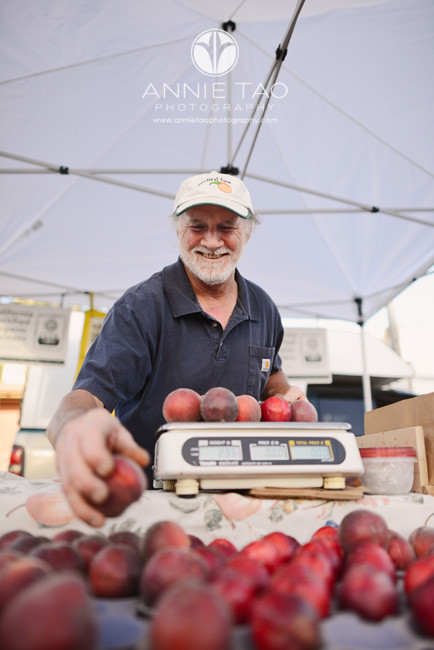 East-Bay-Commercial-Photography-famer-weighing-fruit-at-Berkeley-farmers-market