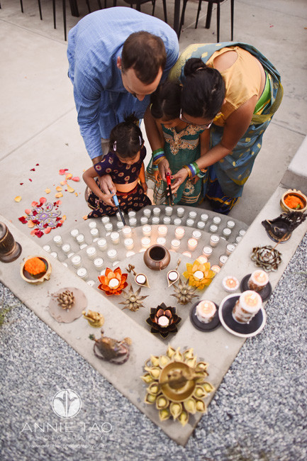 East-Bay-event-photography-family-lighting-candles-at-alter-for-diwali