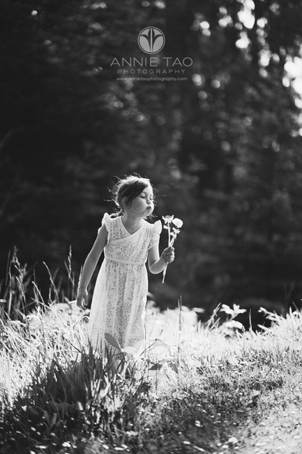 San-Francisco-lifestyle-children-photography-young-girl-blowing-dandelions-BxW