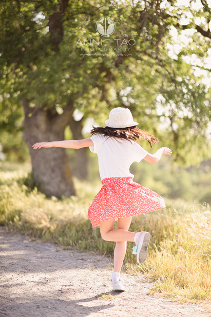 east-bay-lifestyle-children-photography-girl-twirling-coral-skirt