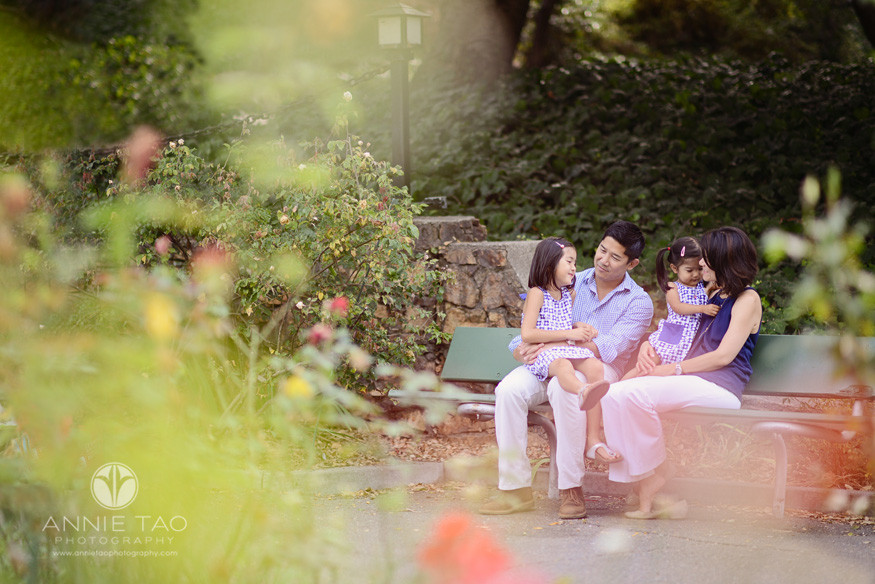 East-Bay-lifestyle-family-photography-family-spending-time-on-bench-view-thru-roses