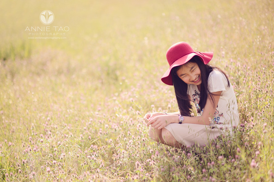 east-bay-lifestyle-children-photography-girl-with-hat-laughing-with-hillside-of-wildflowers