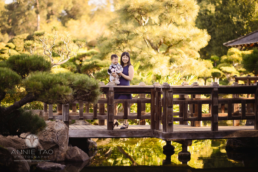 east-bay-lifestyle-family-photography-mother-carrying-toddler-son-on-japanese-bridge