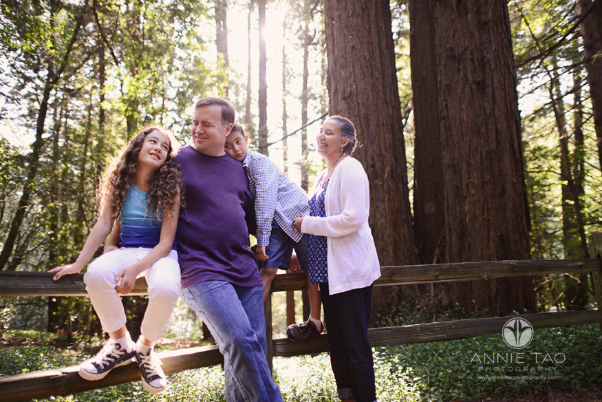 East-Bay-lifestyle-family-photography-family-by-a-fence-in-the-woods-with-sunflare