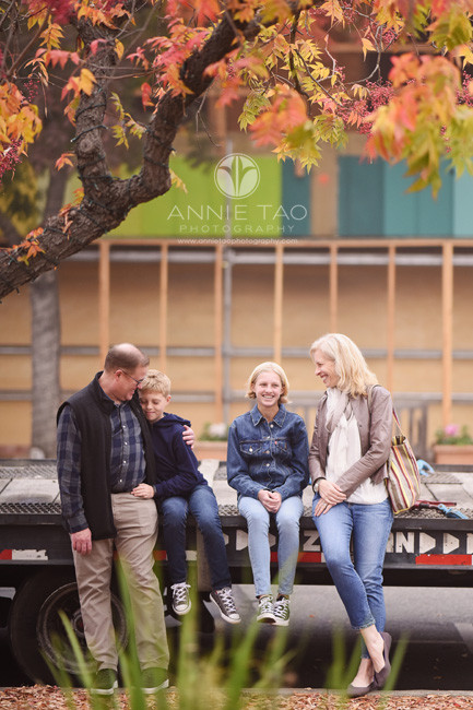 bay-area-los-altos-lifestyle-family-photography-sitting-and-leaning-against-truck-bed-near-colorful-trees