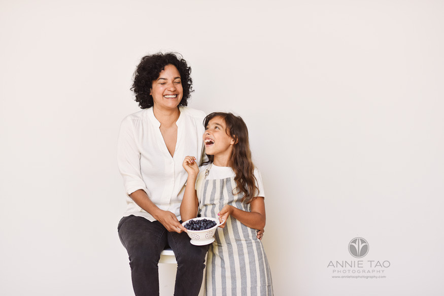 East-Bay-commercial-photography-mother-and-daughter-laughing-with-blueberries