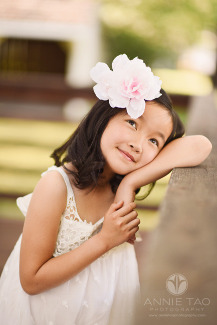 East-Bay-styled-children-photography-young-girl-in-lace-dress-leaning-on-wood-rail