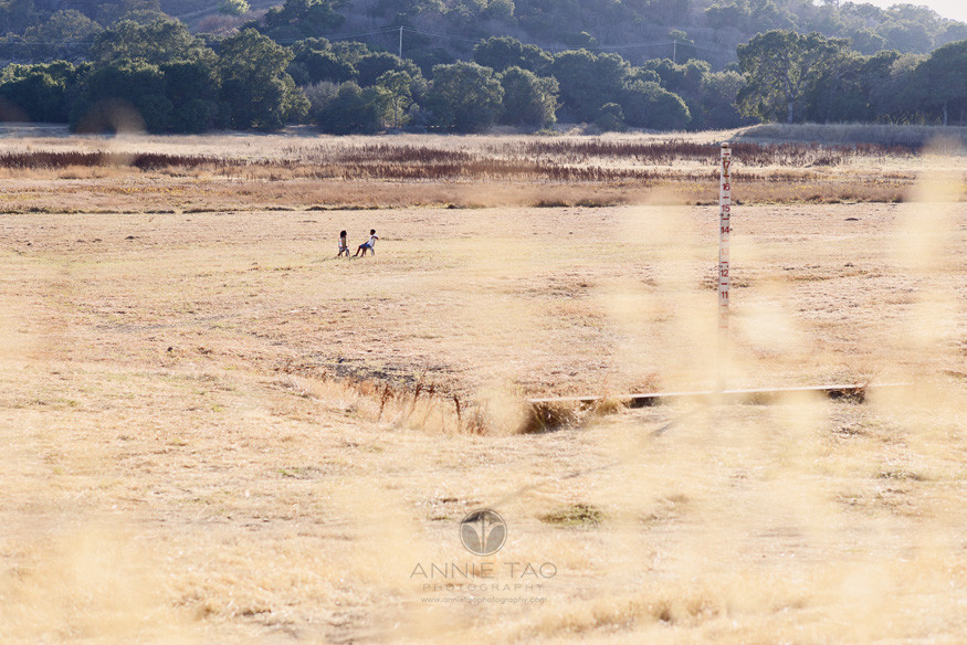 Bay-Area-lifestyle-children-photography-two-siblings-sitting-in-middle-of-dried-up-lake