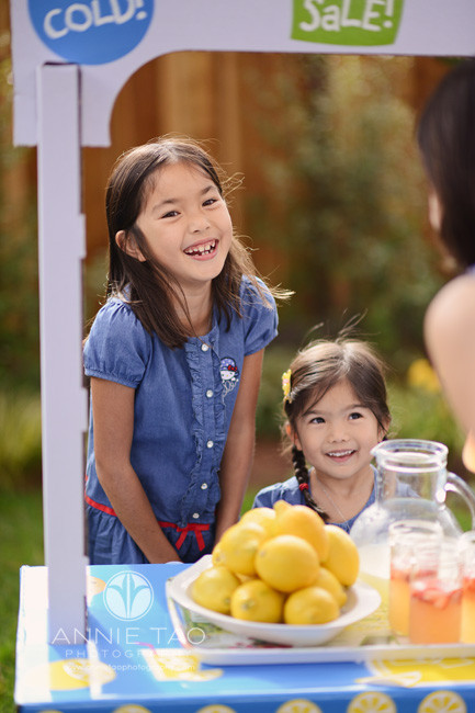 East-Bay-lifestyle-children-photography-sisters-having-fun-selling-lemonade-to-mom