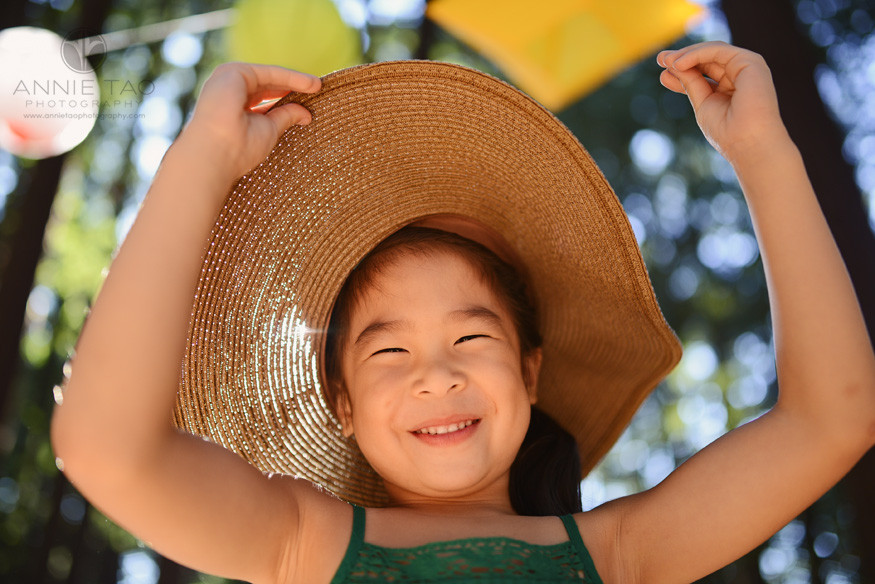 East-Bay-styled-children-photography-young-girl-laughing-after-pulling-away-hat