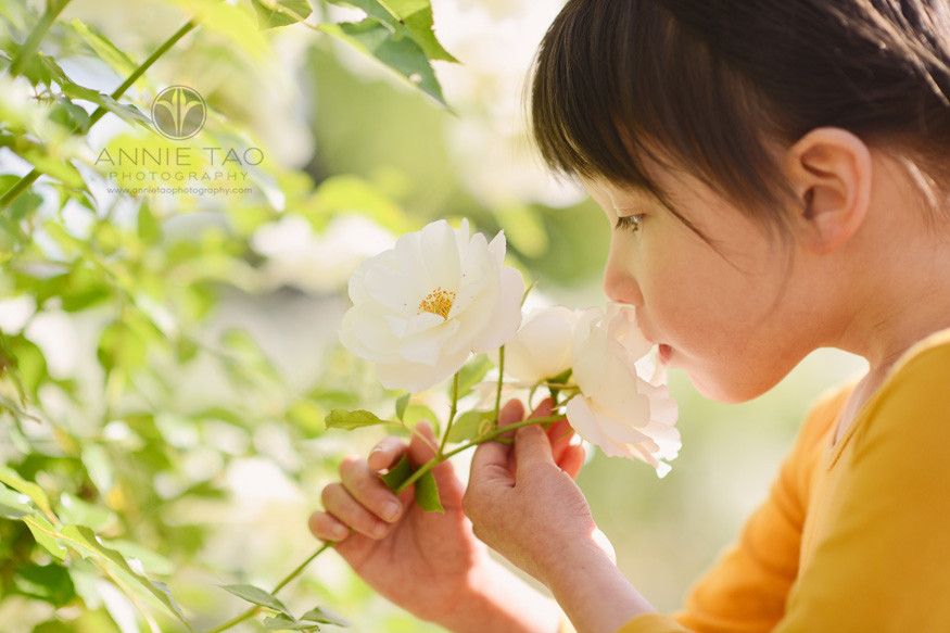 Bay-Area-lifestyle-children-photography-preschooler-girl-in-yellow-smelling-flower-closerup