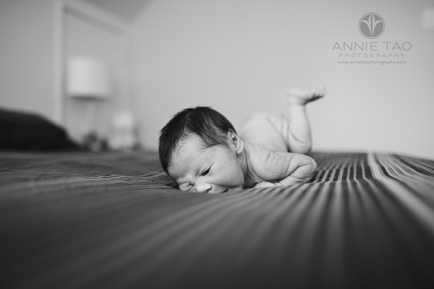 San-Francisco-Bay-Area-East-Bay-Newborn-Photography-naked-baby-rooting-in-the-striped-blanket-BxW
