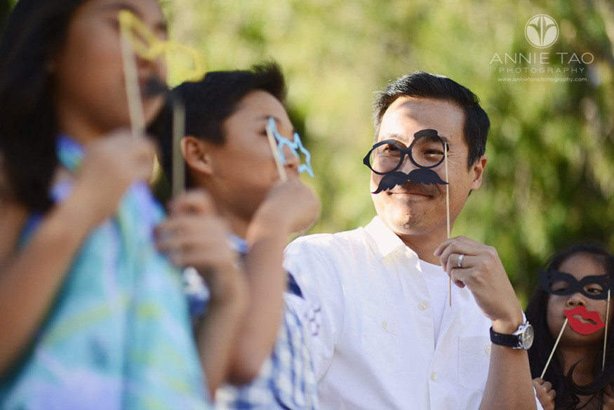 Bay-Area-lifestyle-family-photography-man-being-silly-with-props-to-his-family