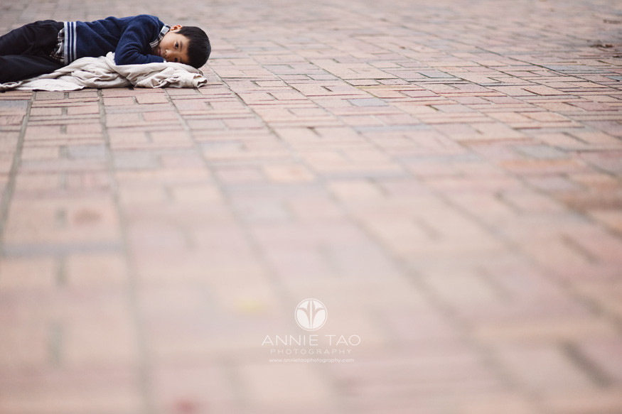 Bay-Area-lifestyle-children-photography-young-boy-laying-on-brick-ground