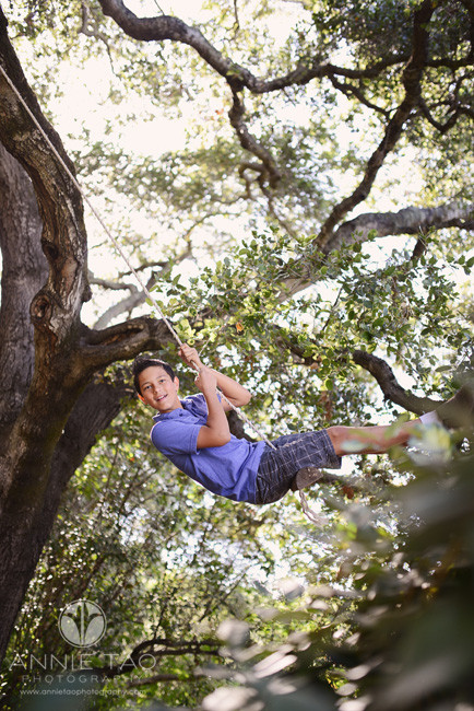 South-Bay-lifestyle-children-photography-middle-school-boy-swinging-high-in-a-tree