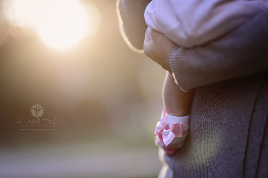 East-Bay-lifestyle-newborn-photography-baby-with-pink-bow-socks-at-sunset