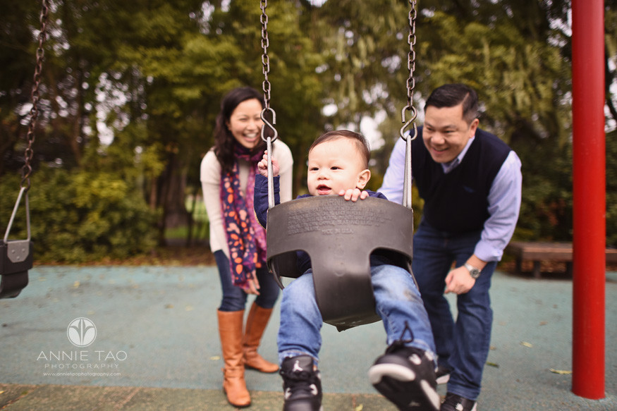 San-Francisco-lifestyle-baby-photography-first-time-on-swing-with-parents-pushing