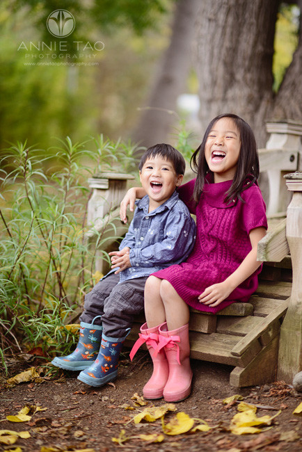 Los-Altos-lifestyle-children-photography-toddler-boy-and-big-sister-laugh-together-on-bridge