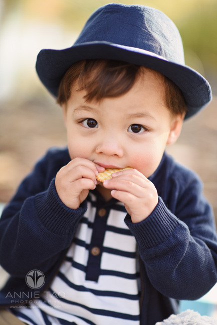 South-Bay-lifestyle-children-photography-toddler-boy-in-hat-eating-a-snack