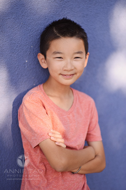 East-Bay-lifestyle-children-photography-boy-against-blue-wall-closeup