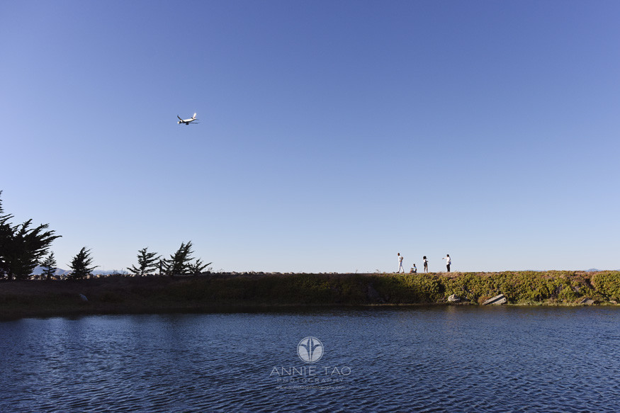 San-Francisco-Bay-Area-lifestyle-family-teen-photography-standing-on-peninsula-while-airplane-flies-overhead