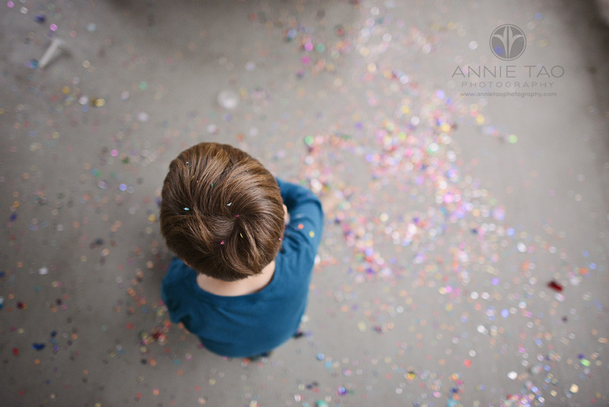 Bay-Area-Palo-Alto-lifestyle-children-photography-top-of-boy-amongst-floor-of-confetti