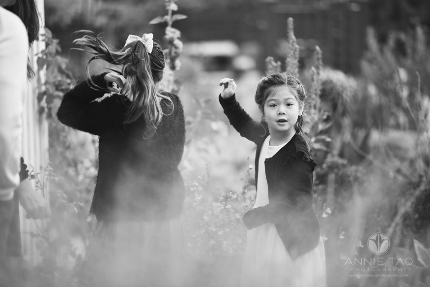 San-Francisco-lifestyle-children-photography-girl-walking-away-another-girl-flicking-ponytail-BxW