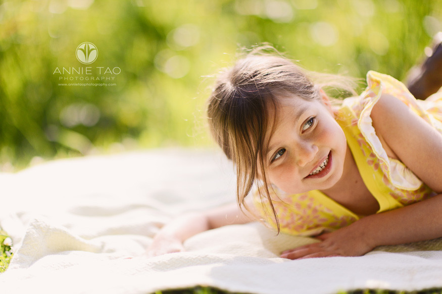 San-Francisco-lifestyle-children-photography-young-girl-in-yellow-laying-down-in-grass