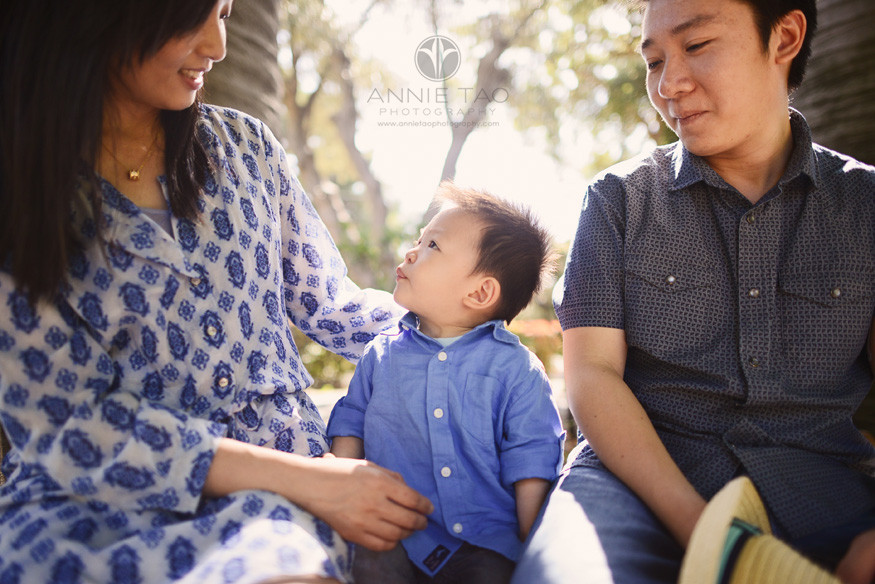 South-Bay-lifestyle-family-photography-toddler-son-sitting-in-between-parents-closeup