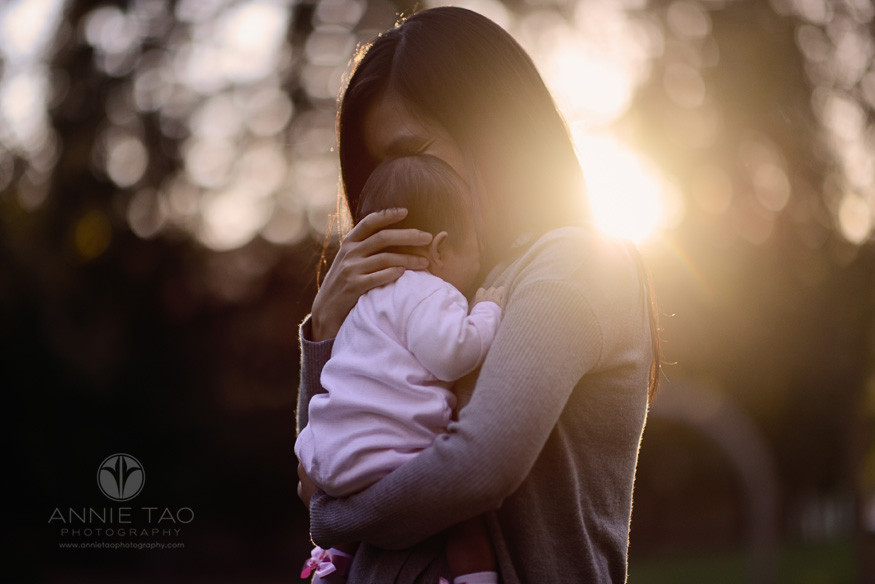 East-Bay-lifestyle-newborn-photography-mother-soothing-newborn-at-sunset
