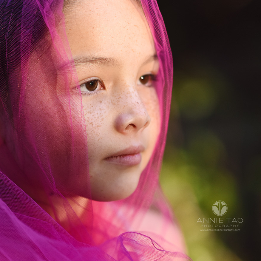east-bay-styled-children-photography-girl-with-freckles-with-bright-pink-head-wrap-extreme-closeup
