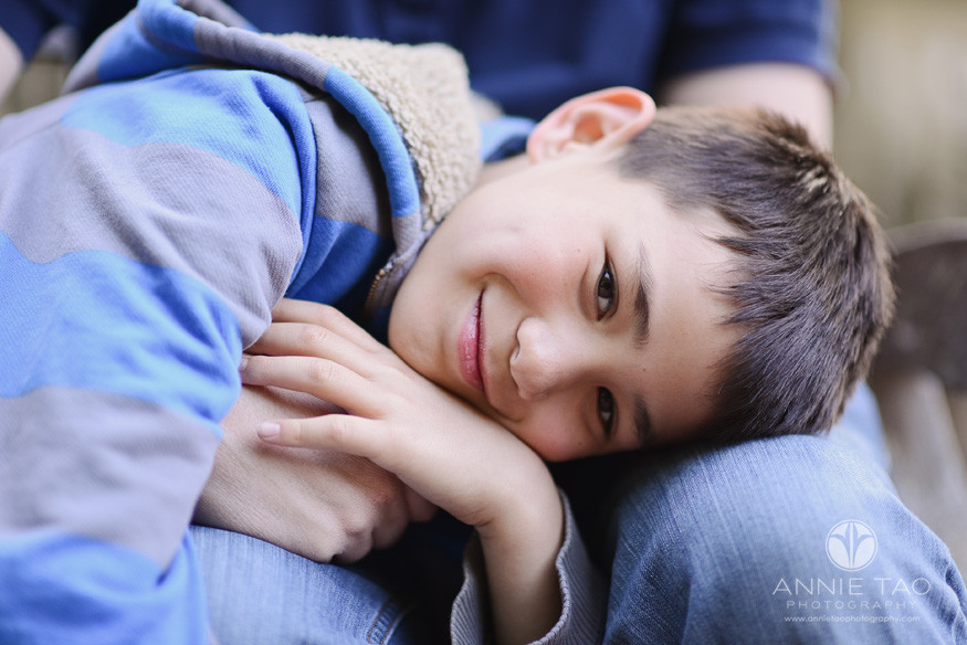 San-Francisco-Bay-Area-lifestyle-children-photography-smiling-boy-laying-on-fathers-lap-closeup