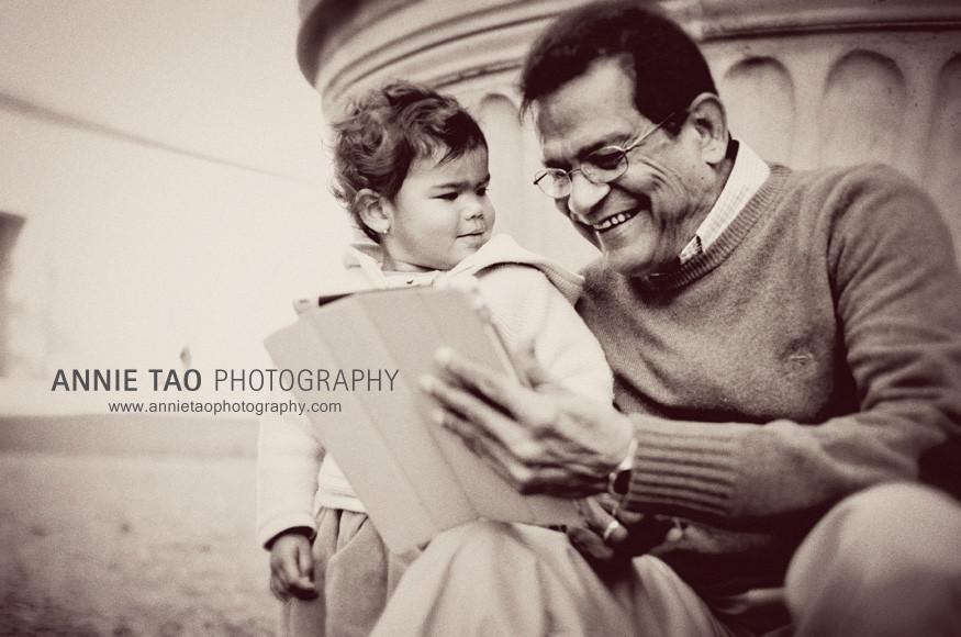 San-Francisco-Bay-Area-family-photography-toddler-watching-grandpa-play-Talking-Ben-on-iPad