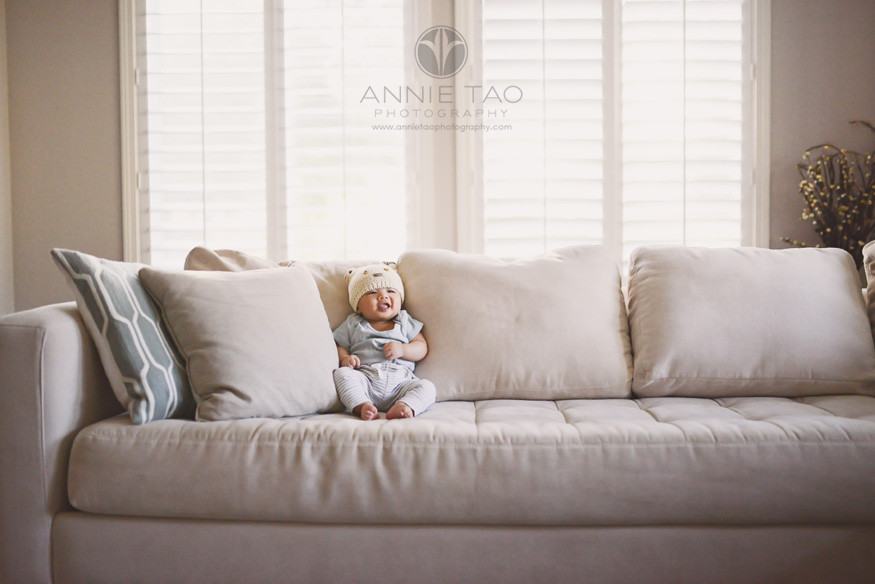 South-Bay-lifestyle-baby-photography-baby-boy-with-hat-sitting-on-long-couch