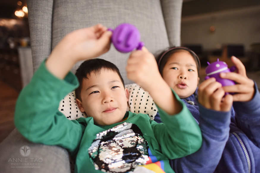 San-Francisco-Bay-Area-lifestyle-children-photography-playing-with-purple-robots-while-seated-together