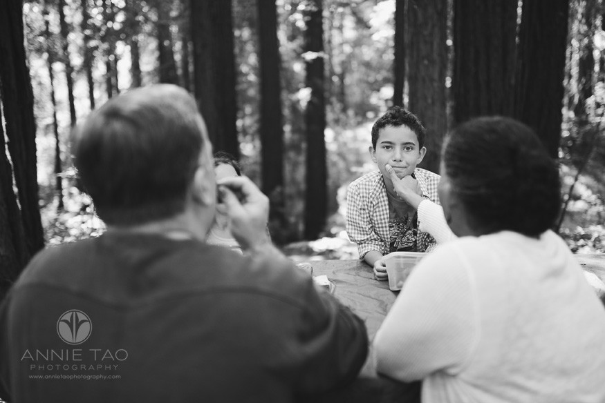East-Bay-lifestyle-family-photography-mom-wiping-sons-face-during-a-picnic-in-the-woods-BxW