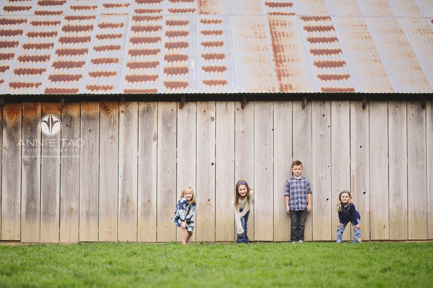 east-bay-lifestyle-children-photography-four-young-children-lined-up-for-a-race-at-farm