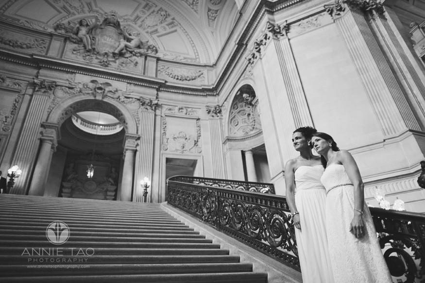 San-Francisco-wedding-photography-City-Hall-gay-wedding-brides-on-a-grand-staircase-BxW