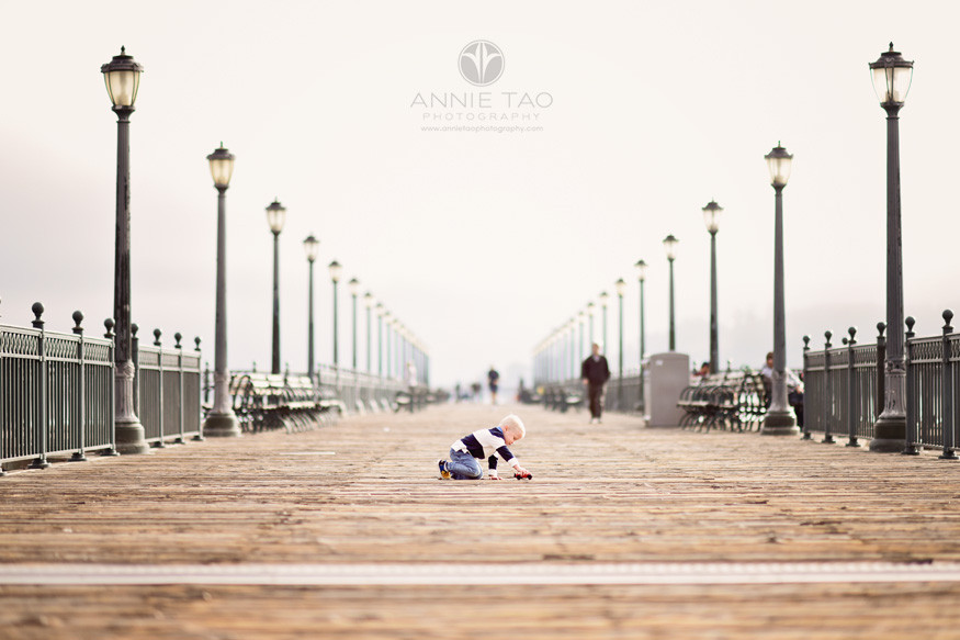 San-Francisco-lifestyle-children-photography-toddler-boy-playing-with-toy-car-on-pier