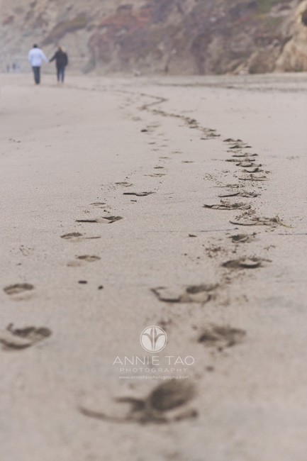 San-Francisco-engagement-photography-couple-walking-together-on-beach-footsteps-view
