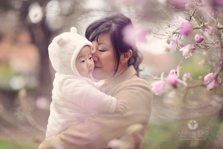 Bay-Area-Palo-Alto-lifestyle-family-photography-mom-smelling-baby-through-japanese-cherry-blossoms